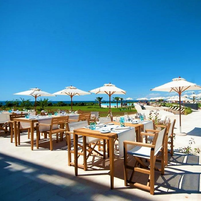 Falkensteiner Hotel &Spa ladera, Zadar outdoor dining facilities and restaurant view of lounge chairs