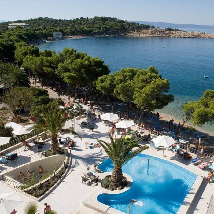 Hotel Park, Makarska room view of outdoor pool, lounge chairs and Adriatic sea
