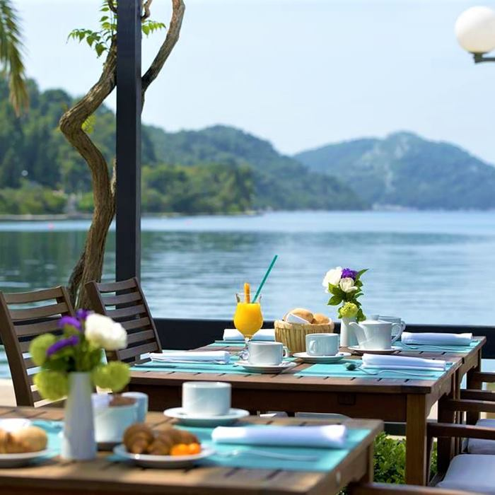 Hotel Sipan, Sipan island outdoor dining area with sea view during the day