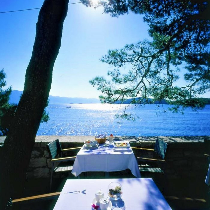 Lesic Dimitri Palace, Korcula outdoor dining area with sea view and natural shade