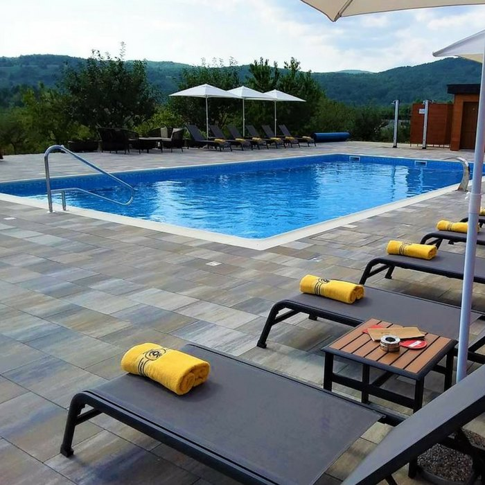 Hotel Degenija, Plitvice Lakes outdoor pool with sun bathing chairs and lounge area