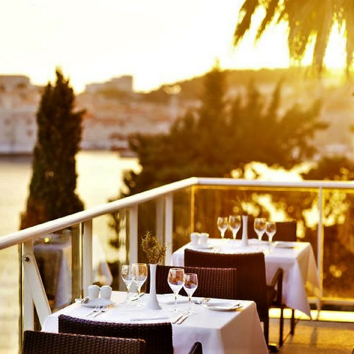 Grand Villa Argentina, Dubrovnik outdoor dining area wit sea and old town view