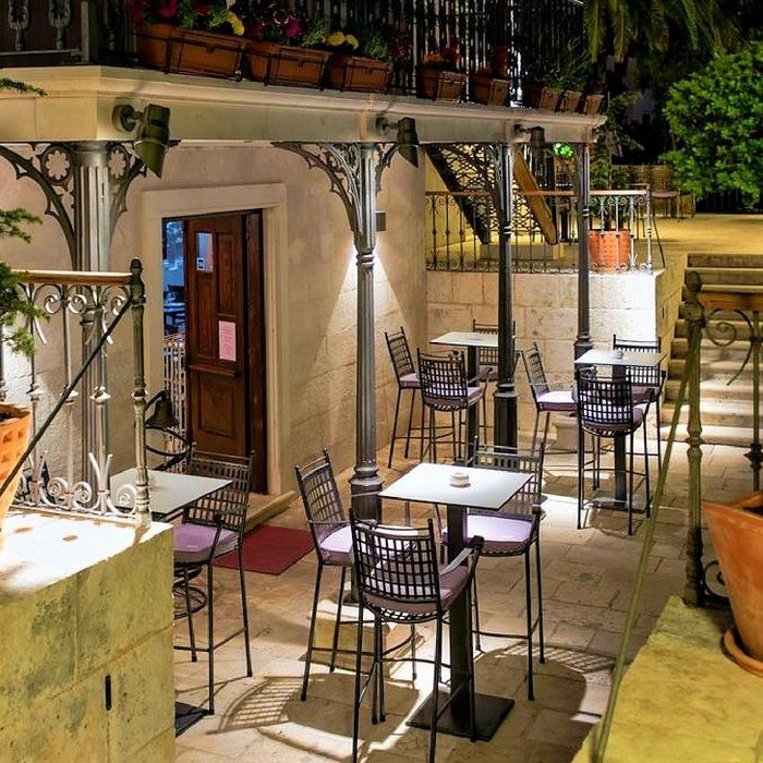 Heritage Villa Apolo, Stari Grad bar stools and tall tables outdoor seating