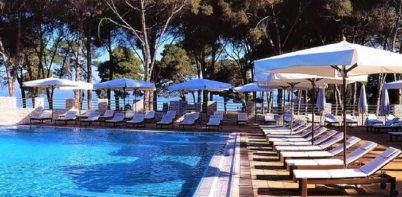 Falkensteiner Hotel Adriana, Zadar pool front view of outdoor lounge chairs