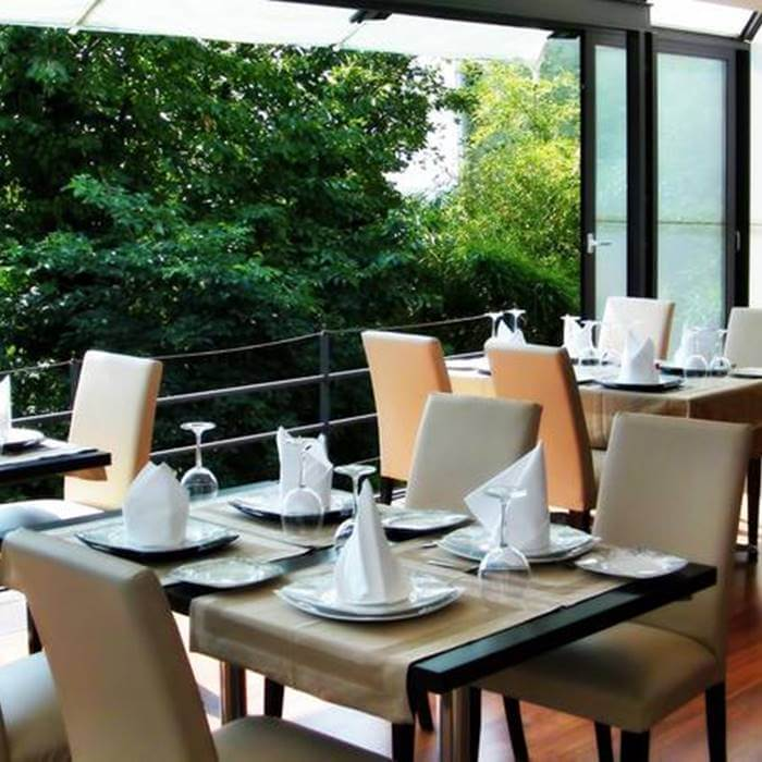 Hotel President, Zagreb outdoor dining area with forest
